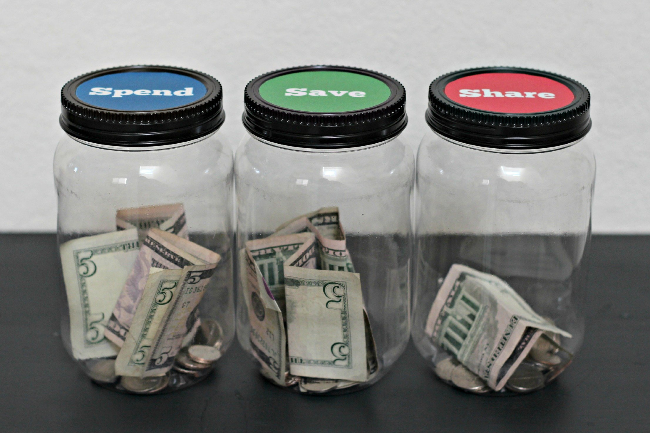 3 jars with money inside of them