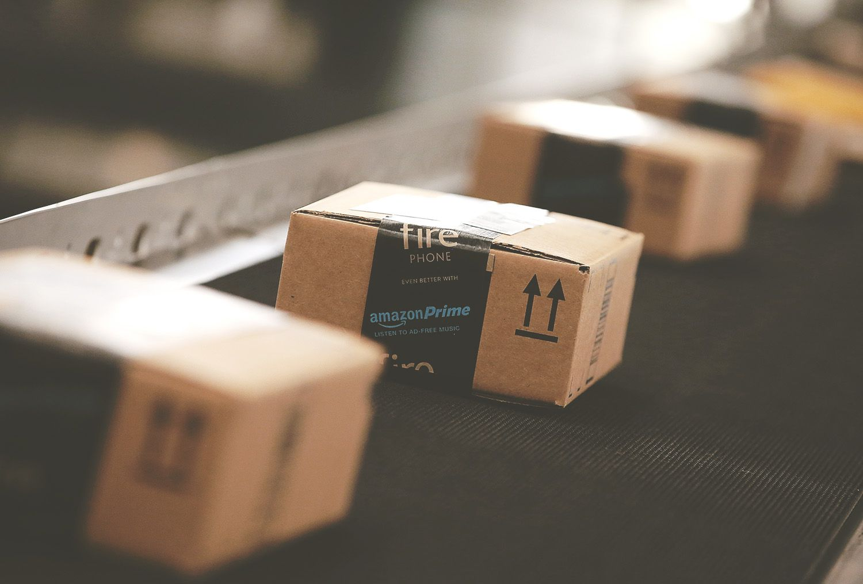 amazon prime boxes on a belt